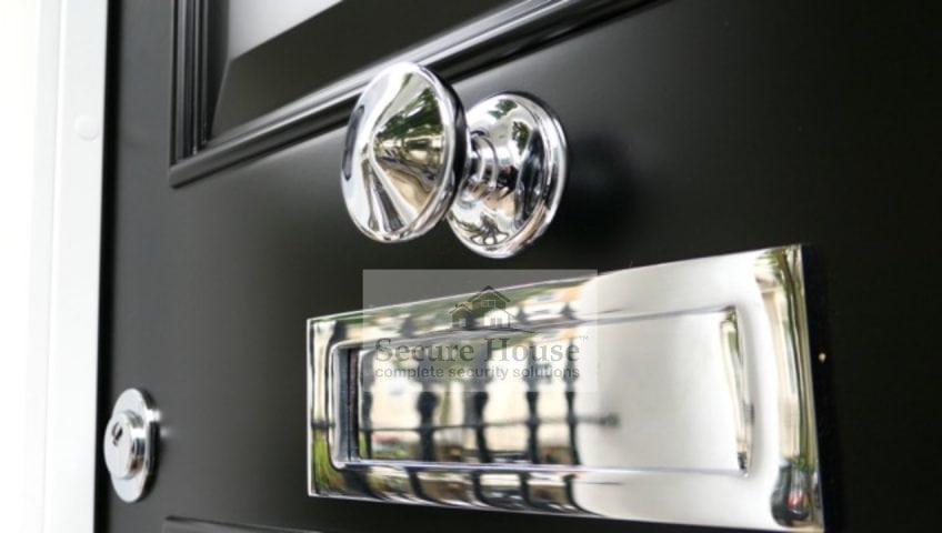 Luxurious ironmongery from Secure House - highly polished silver finish door pull and letterbox
