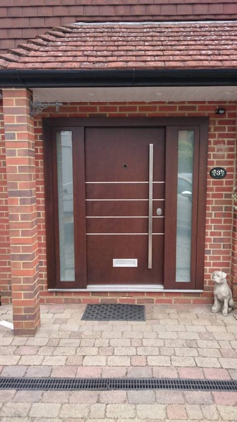 Glazed panels and brushed steelwork make this security door stand out for all the right reasons