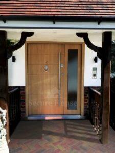009.high security door single with side panel oak front modernd door 225x300 - What doors provide the best security?