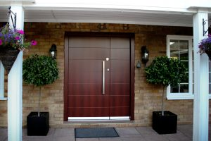 Steel security door with timber-effect finish