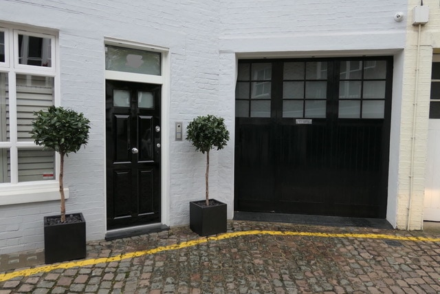 Matching conservation doors and garage doors for Kensington mews