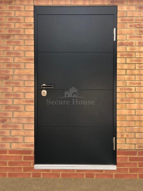 Black horizontal line flush door with bespoke ironmongery