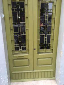 Lime green security door with stunning leaded glass inserts
