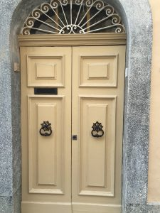 Cream panelled security door with iron star design knockers