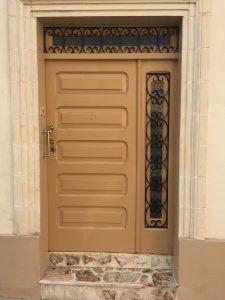 Caramel coloured security door with intricate ironmongery