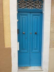 Mediterranean blue security panelled door with traditional door furniture