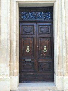 Traditional panelled security door with drop door knockers