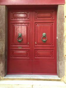 Pillar box red door with roaring lion double door knockers