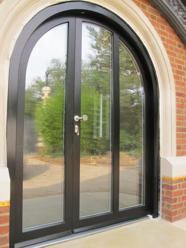 Arched door with high security glazing