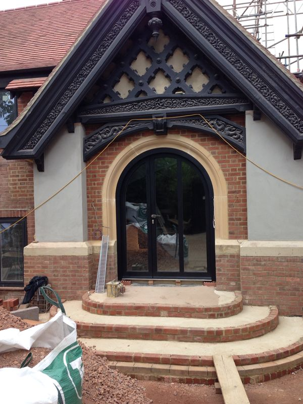 Arched door with high security glass
