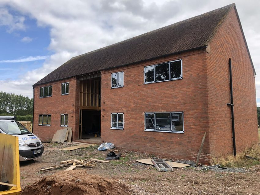 On site at the farmhouse installing the Reynaers SL68 ultra-slim, weather resistant aluminium windows